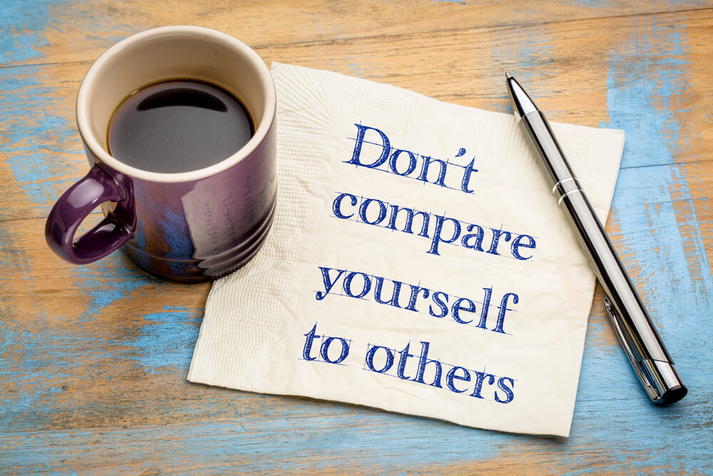 handwritten don't compare yourself message on napkin