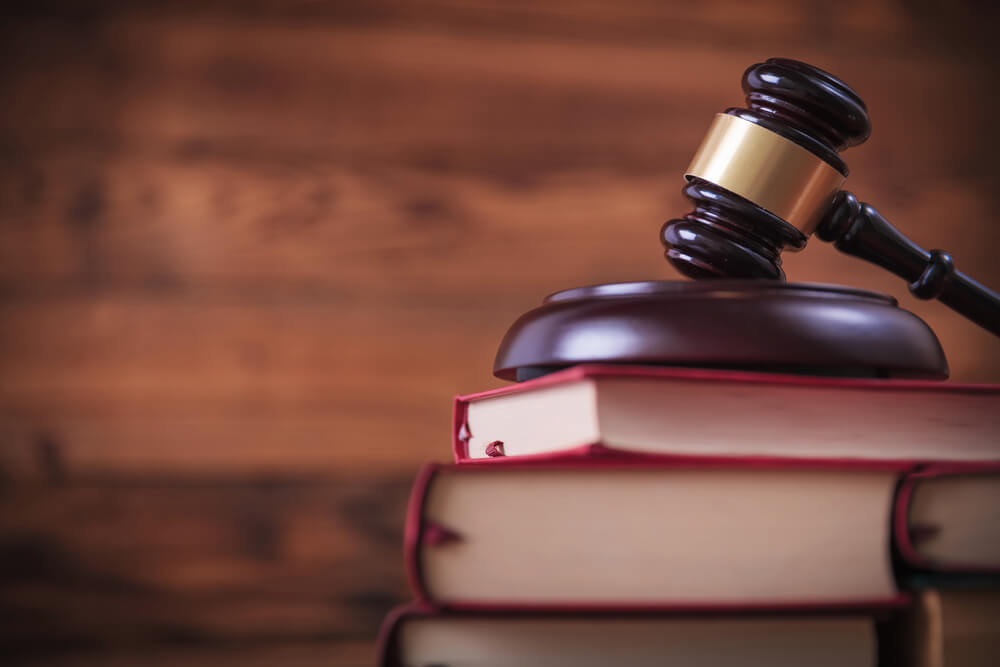 judge gavel on law textbooks