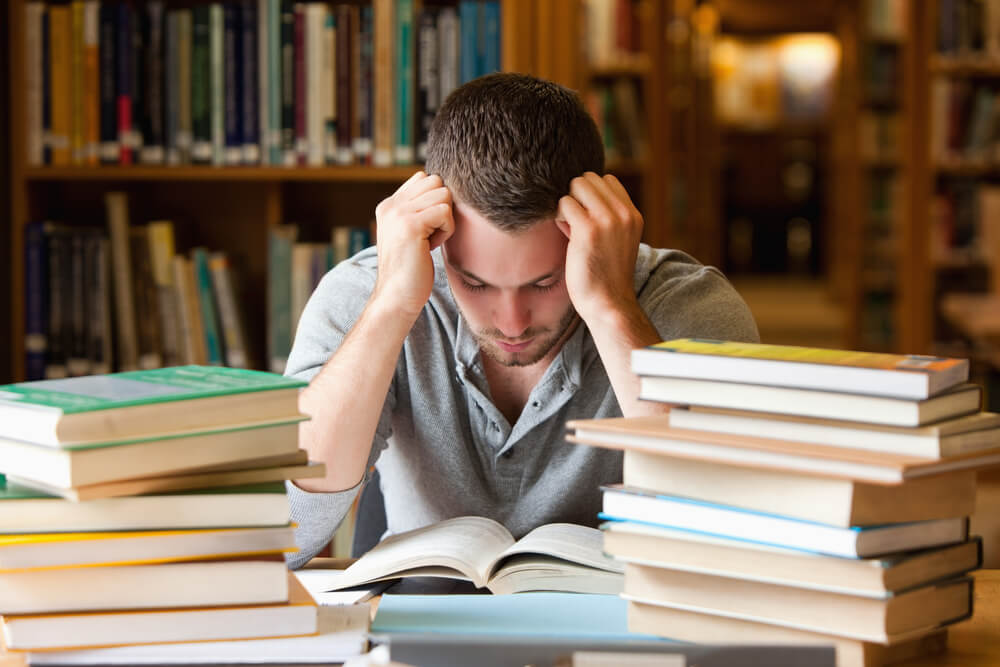 stressed student reading in library